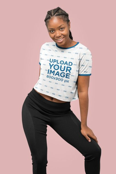 Mockup of a Woman with a Sublimated Ringer Crop Top at a Studio 31136