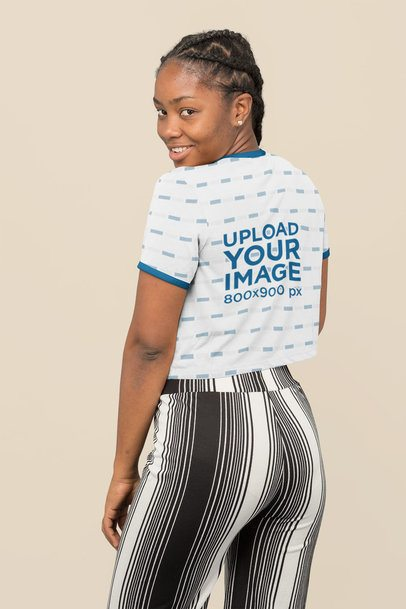 Back-View Mockup of a Woman Wearing a Sublimated Ringer Crop Top 31135
