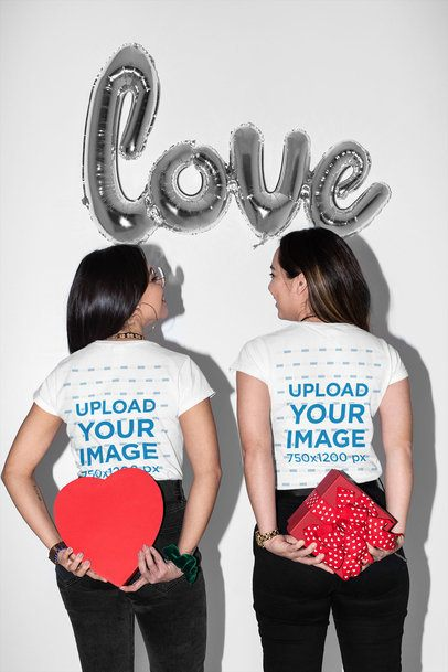 Back-View Mockup of Two Women Wearing T-Shirts by Valentine's Balloons 31235