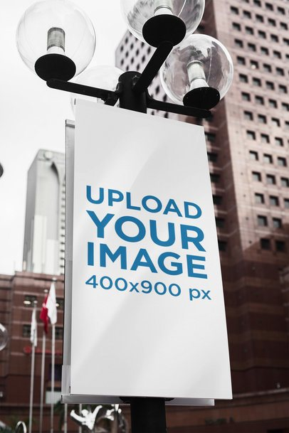 Mockup of a Banner Sign Attached to a Street Light Pole 2307-el1