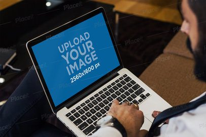 Mockup of a Bearded Man Using His Macbook Pro 2322-el1