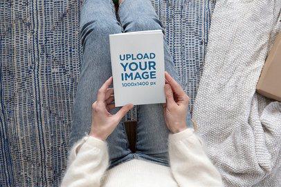 Book Mockup of a Woman in a Cozy Setting 2355-el1