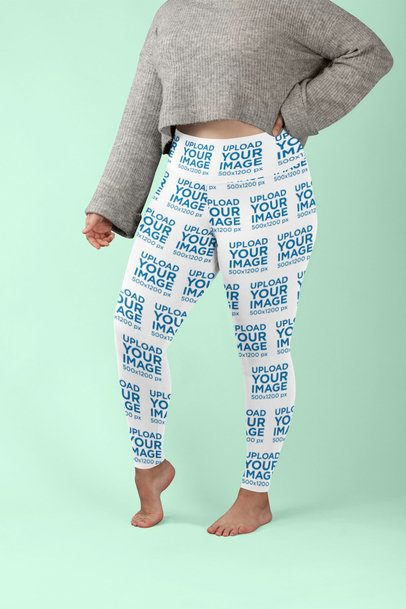 Plus Size Leggings Mockup Featuring a Woman Posing against a Colored Backdrop 30975
