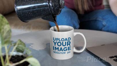 Video of a Woman Pouring Coffee Into an 11 oz Mug 31586