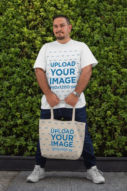 Plus Size T-Shirt Mockup of a Man Holding a Tote Bag 31052