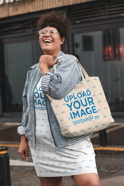 Plus Size Shift Dress Mockup Featuring a Woman Laughing and Holding a Tote Bag 30954