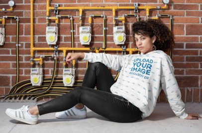 Sublimated Hoodie Mockup of a Woman Posing by Some Pressure Valves 31163