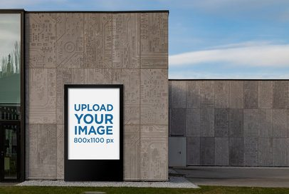 Mockup Featuring a MUPI Placed against a Modern Concrete Wall 2479-el1