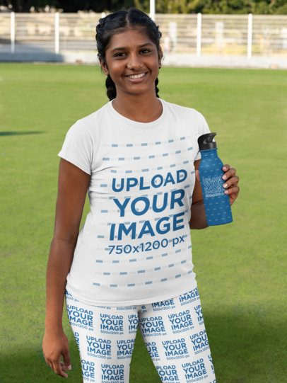 T-Shirt Mockup Featuring a Woman Wearing Leggings and Holding an Aluminum Bottle 31343