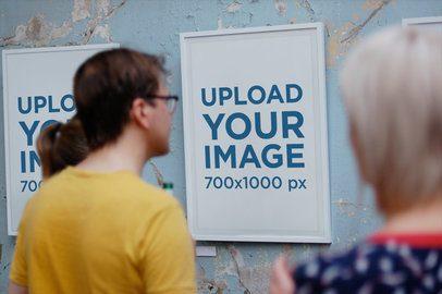 Mockup of a Group of People Admiring an Art Print 2634-el1