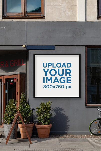Mockup of a Poster Display Case Placed on a Restaurant Facade 2497-el1
