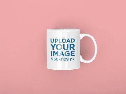Mockup of an 11 oz Coffee Mug Lying on a Solid Color Surface 31889
