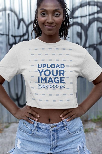 Crop Top Mockup Featuring a Smiling Woman with Graffiti in the Background 32047