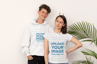 Pullover Hoodie Mockup of a Son and His Mom in a Tee Doing Funny Faces 31443