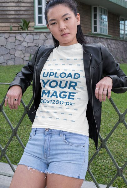 T-Shirt Mockup of a Woman Leaning on a Fence 32056