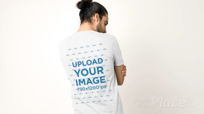 Video of a Tattooed Man Showing the Back of His T-Shirt to the Camera 32028