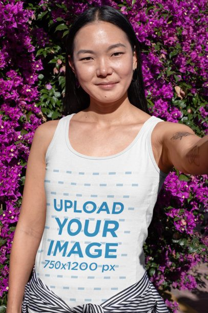 Tank Top Mockup of a Woman Taking a Selfie Against a Bougainvillea 32057
