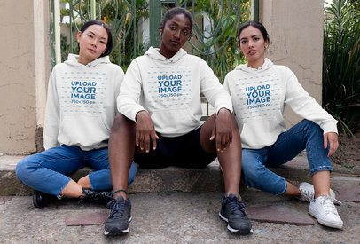 Pullover Hoodie Mockup Featuring Three Women Sitting on a Curb 32062