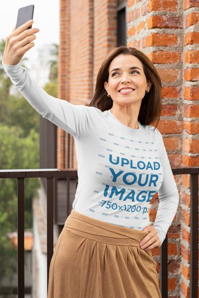 Long Sleeve Tee Mockup of a Middle-Aged Woman Taking a Selfie in the Balcony 31611