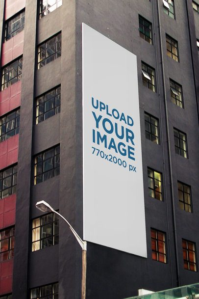 Mockup of a Vertical Billboard on a Gray Modern Building 2869-el1