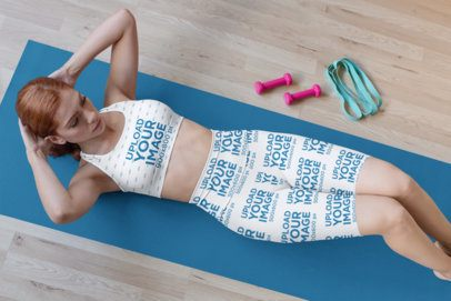 Sports Bra Mockup of a Woman Wearing Bike Shorts and Doing a Workout Routine 31520