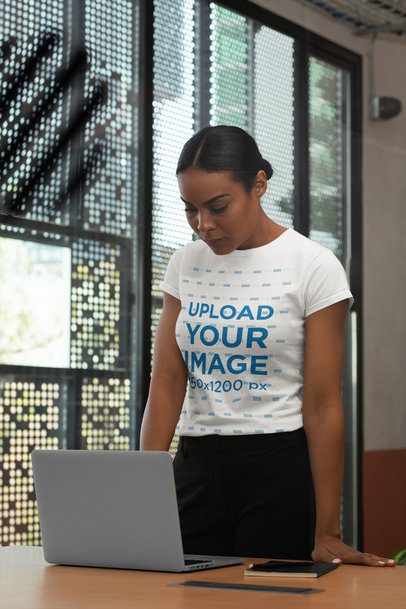 Mockup of a Middle-Aged Woman Wearing a T-Shirt and Looking at Her Computer 31706