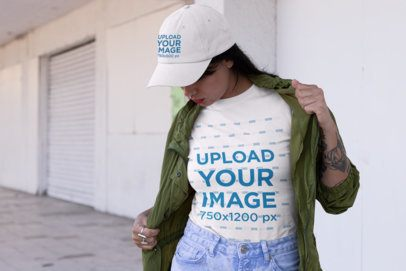 Mockup Featuring a Woman with a Tee and a Dad Hat on the Street 31182