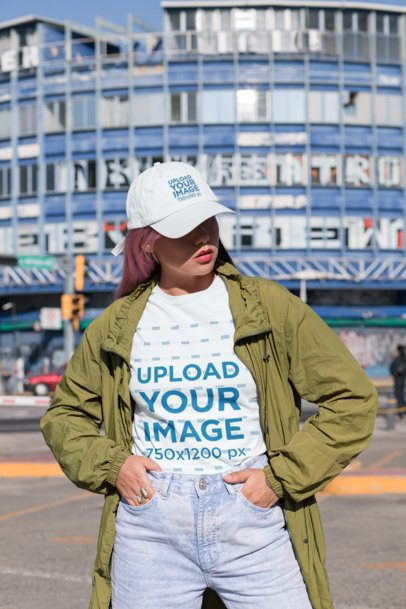 T-Shirt Mockup Featuring a Young Woman with a Dad Hat in an Urban Scenario 31183