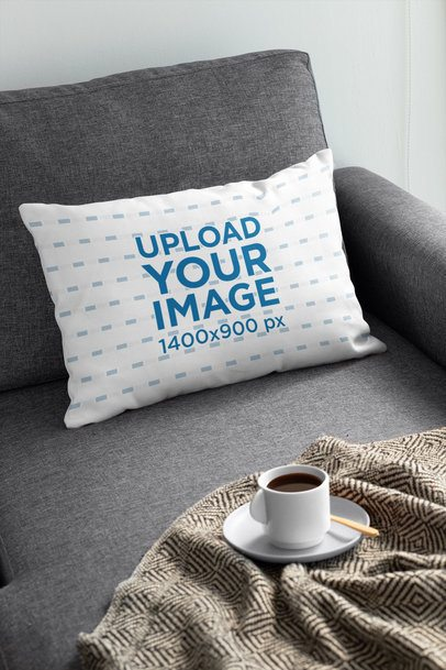 Pillow Mockup Featuring a Cup of Coffee on a Sofa 31306