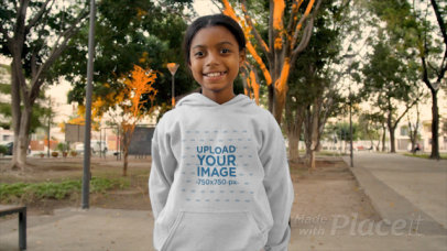 Hoodie Mockup Video of a Girl Holding a Mother's Day Card 32348