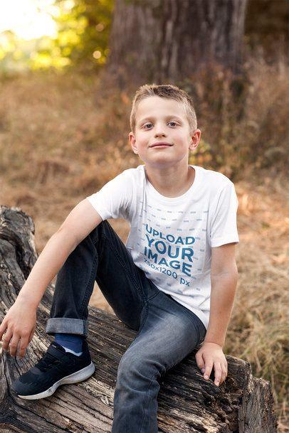 T-Shirt Mockup of a Boy Sitting on a Log 2924-el1