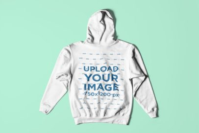 Back-Side Mockup of a Hoodie Over a Customizable Surface 3025-el1