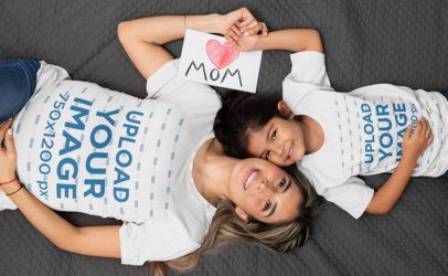 T-Shirt Mockup Featuring a Mom and Her Little Daughter Lying Down 32246
