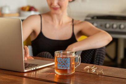 11 oz Clear Glass Mug Mockup Featuring a Woman Working at Home 31762