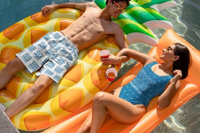 Swim Trunks and Swimsuit Mockup of a Man and a Woman Hanging Out in a Pool 32685