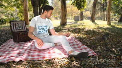 T-Shirt Video of a Man Feeding a Squirrel at a Park 32731