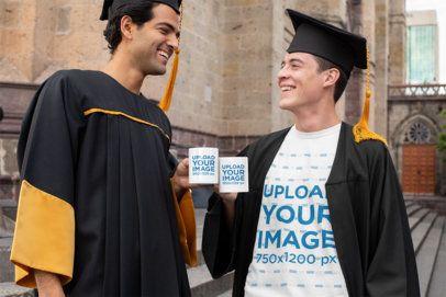 T-Shirt Mockup of Two Men Holding 11 oz Coffee Mugs on Graduation Day 32627