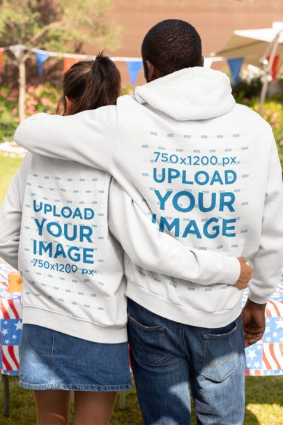 Hoodie Mockup of a Couple Hugging on the 4th of July 33023