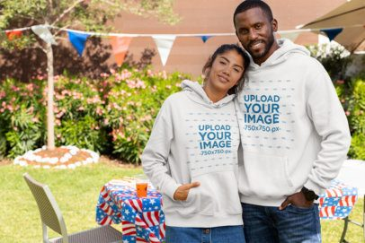 Hoodie Mockup of a Couple Celebrating the 4th of July 33024