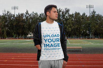 T-Shirt Mockup of a Man at a Running Track 32508