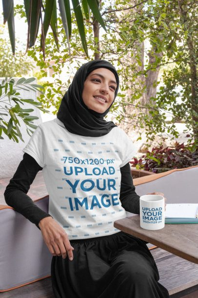 T-Shirt Mockup of a Woman Wearing a Hijab with an 11 oz Mug in Her Hand 32401