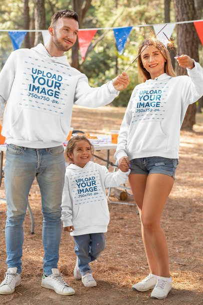Hoodie Mockup Featuring a Family of Three Celebrating 4th of July 33042