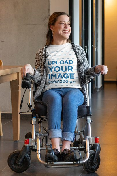 T-Shirt Mockup of a Smiling Woman Using a Wheelchair in a Hall 32533