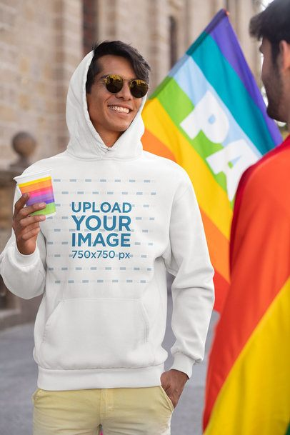 Mockup of a Man with a Hoodie and Sunglasses at the Pride Parade 32988