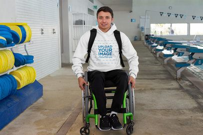 Hoodie Mockup of an Athlete Using a Wheelchair by a Pool 32491