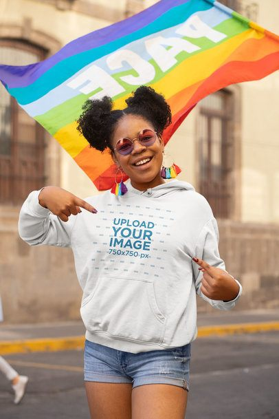 Mockup Featuring a Woman Pointing at Her Hoodie During an LGBT Pride Parade 33005