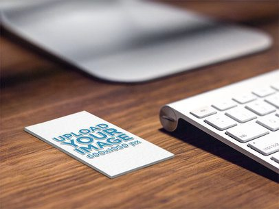 Mockup of an Embossed Vertical Business Card on a Desk 33768