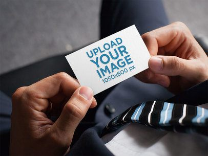 Mockup of a Man Holding a Business Card with an Embossed Texture 33770