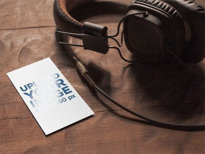 Mockup of a Varnish Business Card Placed Next to a Pair of Headphones 33795