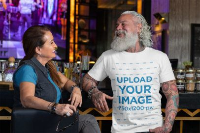 T-Shirt Mockup of a White-Bearded Man Chatting with a Woman at a Bar 32867